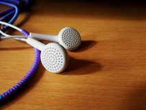 White earphones with wire protector Royalty Free Stock Images