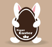 White Easter Bunny with a chocolate Easter egg. Royalty Free Stock Photography