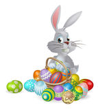 White Easter bunny and chocolate eggs Royalty Free Stock Photos