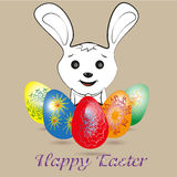 White Easter bunny and colored eggs Royalty Free Stock Photos