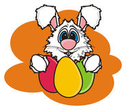 White Easter Bunny holding colorful eggs Royalty Free Stock Photos