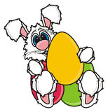 White Easter Bunny holding colorful eggs Royalty Free Stock Image