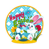 A white Easter bunny rabbit holds a large Easter colored egg with a pattern of daisies. Glade with flowers and grass. Greeting car Stock Photos
