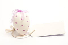 White easter egg with blank tag Royalty Free Stock Photo