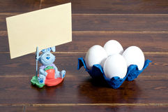 White easter eggs and bunny with greeting card Royalty Free Stock Images