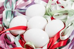 White Easter Eggs on Colorful Stock Photo