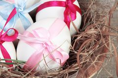 White Easter Eggs with Colorful Bows Close Stock Image