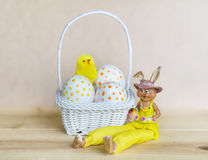 White easter eggs  with dots in small white basket Stock Photo
