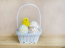 White easter eggs  with dots in small white basket Stock Photos