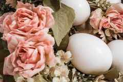 White Easter Eggs Ornement. Close view of white easter eggs ornement with colorful flowers Stock Photos