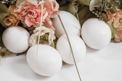 White Easter Eggs Ornement. With colorful flowers on white background Stock Photo