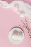 White Easter eggs on white plate on a light pink background Stock Photo