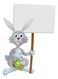 White Easter rabbit holding sign vector illustration