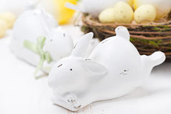 White easter rabbits and basket with eggs, close-up Stock Image