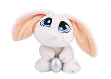 White easter toy rabbit with silver egg. Royalty Free Stock Photos