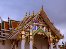 White edged tympanum in Thailand in rainy day. White edged tympanum of the temple in Thailand in rainy day Stock Image