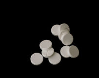 White effervescent tablets on black background Royalty Free Stock Photos
