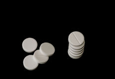 White effervescent tablets on black background Royalty Free Stock Images