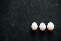 White egg on black background stock photos