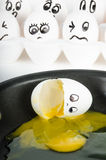 White egg with face broken in skillet Royalty Free Stock Photo