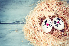 White egg with funny face Stock Photos