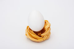 White egg in pasta nest Royalty Free Stock Photo