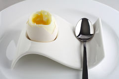 White egg on plate with spoon Stock Image