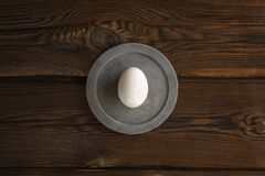 White egg on round concrete slab royalty free stock photos