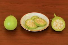 White eggplant in plate cup closeup on isolated background royalty free stock photos