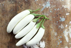 White eggplant or white aubergine. On rustic wooden background stock photo