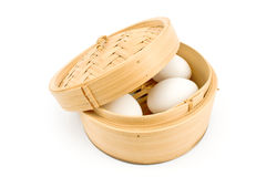 White eggs in bamboo basket under lid Stock Images