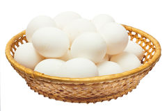 White eggs in the basket stock photo