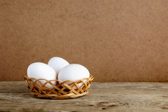 White eggs in basket Stock Image