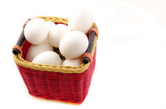 White eggs on a basket isolated Royalty Free Stock Image