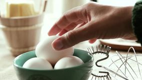 White eggs being picked up, Slow Motion stock footage
