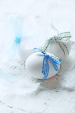 White Eggs with Blue Ribbons Royalty Free Stock Photos