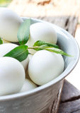 White eggs in bowl. With old wood Stock Photos
