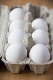 White eggs in box. A few white eggs in box for breakfast Royalty Free Stock Images