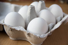 White eggs in box. A few white eggs in box for breakfast Royalty Free Stock Image