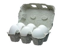 White eggs in container isolated Stock Photos