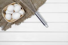 White eggs corolla. On a white wooden background Stock Photography
