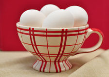 White eggs in a cup Royalty Free Stock Photos