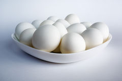 White eggs in the dish Stock Images