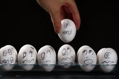White eggs with distress faces Stock Image