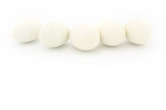White eggs. Five white eggs in a row,  on white background Stock Images
