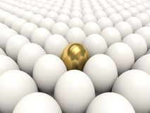White eggs with golden egg Royalty Free Stock Image