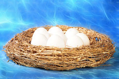 White eggs in golden nest Stock Photo