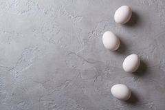 White eggs on a gray concrete table. Easter photo concept. Copy space Royalty Free Stock Images