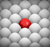 White eggs and one red egg background Royalty Free Stock Photos