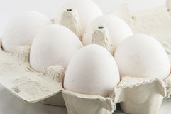 White eggs in a package to isolate Royalty Free Stock Photography